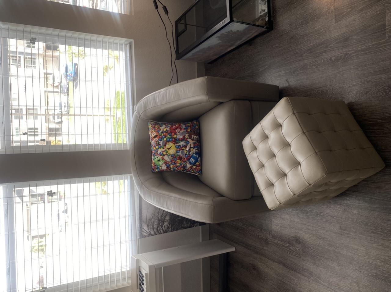 Beige chair and foot stool