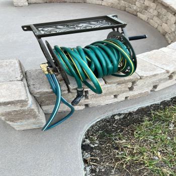 Garden hose holder.
